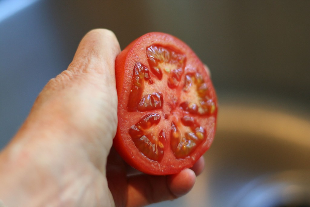 Holding Tomato Half for Squeezing