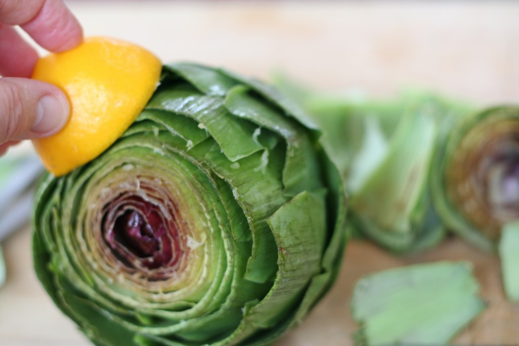 Rubbing the Trimmed Leaves of an Artichoke with Lemon